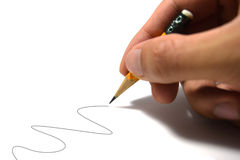 Holding pencil to write wave line isolate on white background Royalty Free Stock Photo