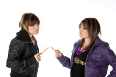 Holding pencils pointing at each other Stock Photo