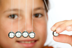 Holding a pendulum ball Stock Images