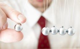 Holding a pendulum ball