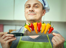 Holding peppers on a knife Royalty Free Stock Photography