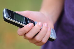 Holding a Phone. A close up view of someone holding a wireless phone Stock Photos