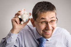 Holding a piggy bank Royalty Free Stock Photography