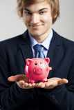 Holding a piggy bank Royalty Free Stock Photo
