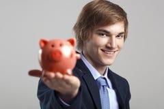 Holding a piggy bank Royalty Free Stock Photos