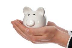 Holding piggy bank Royalty Free Stock Image