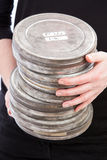 Holding Pile of Film Cans Stock Images