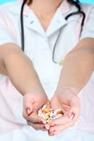 Holding pills Stock Photos