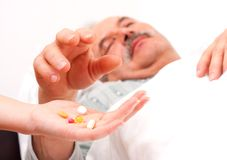 Holding pills Royalty Free Stock Photography