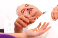 Holding pills Stock Photography