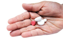 Holding pills in hand Stock Photography