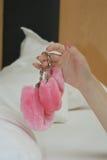 Holding pink cuffs Stock Photos