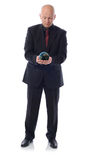 Holding planet. Man in a suit holding the planet earth isolated on white background Stock Photography