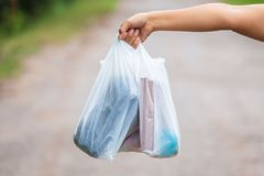 Holding Plastic Bags. Closeup woman show the plastic bags in hand stock image