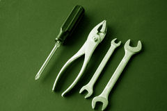 Holding Pliers & wrenches tools Royalty Free Stock Photography