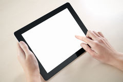 Holding And Point On Electronic Tablet PC. Woman hands holding and point on electronic tablet pc with blank screen Royalty Free Stock Photography