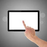 Holding and Point on Tablet PC. Hand pointing Tablet PC. Gradually varied background royalty free stock image