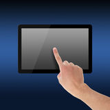 Holding and Point on Tablet PC Royalty Free Stock Images