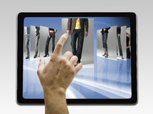 Holding and pointing to blank screen Royalty Free Stock Photography
