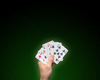 Holding Poker cards stock photos