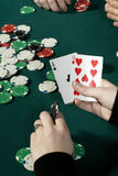 Holding poker hand. With chips on table stock photo