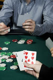 Holding poker hand Stock Image