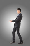 Holding pose of Asian business man Royalty Free Stock Images