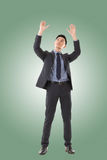 Holding pose of Asian business man Royalty Free Stock Photography
