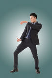 Holding pose of Asian business man Stock Photo
