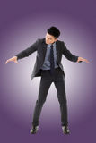 Holding pose of Asian business man Royalty Free Stock Photos