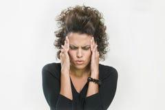 Holding preoccupata della donna la sua testa Fotografia Stock Libera da Diritti