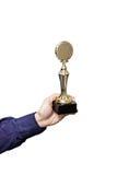Holding prize Stock Image
