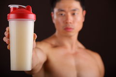 Holding a Protein Shake Jar Royalty Free Stock Image