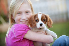 Holding puppy. Girl holding her new puppy Royalty Free Stock Image