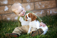 Holding puppy. Baby holding his new puppy Royalty Free Stock Images