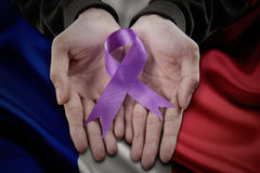 Holding purple domestic violence awareness ribbon Royalty Free Stock Photos