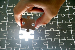 Holding a puzzle piece Stock Image