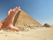 Holding a Pyramid stock images