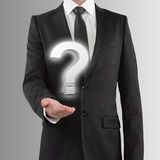 Holding question mark Stock Photography