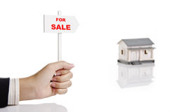 Holding real estate sign stock photography