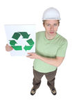 Holding a recycle sign Royalty Free Stock Images