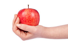 Holding a red apple Stock Images