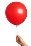 Holding red  balloon Royalty Free Stock Photos