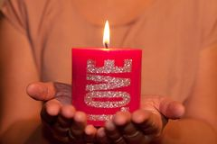 Holding red candle Stock Photography