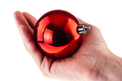 Holding a red christmas ball Stock Photo