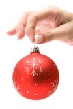 Holding a Red Christmas Tree Ball stock photography