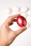 Holding a red egg Royalty Free Stock Photos