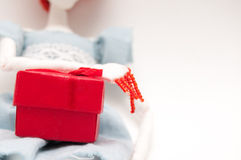 Holding a red gift box Royalty Free Stock Photos