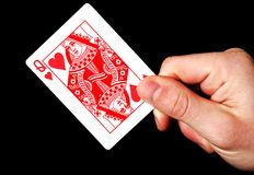 Holding Red Queen card Stock Photography