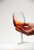 Holding red wine in glass. And shake for tasting. Check quality of red wine Royalty Free Stock Photo